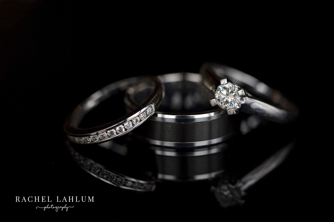 Wedding ring macro photo reflecting on a black grand piano